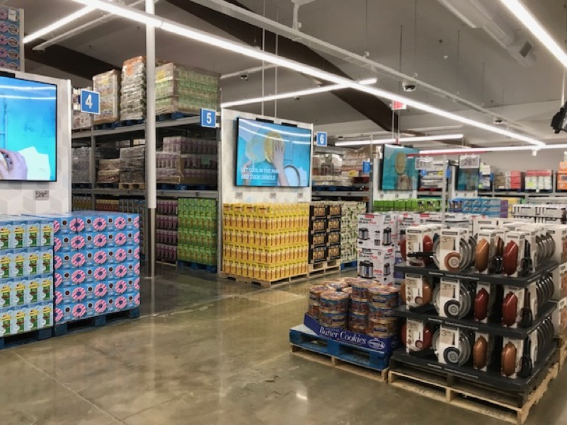 Sam's Club Now: Pallets and bulk packages line shelves